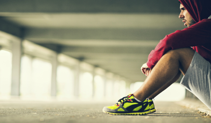 Runner sits after suffering plantar fasciitis