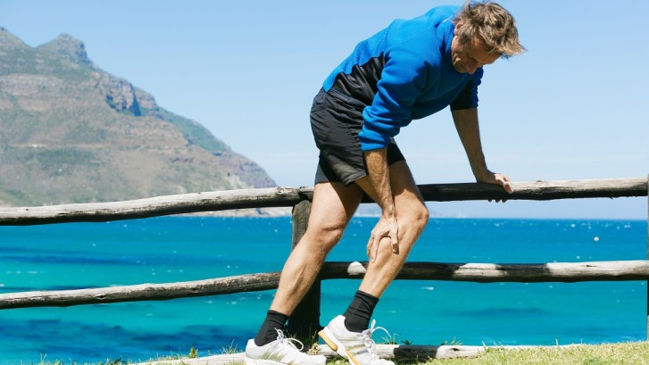 Charley horse pain in the calf of a male jogger. Could be muscle cramp!