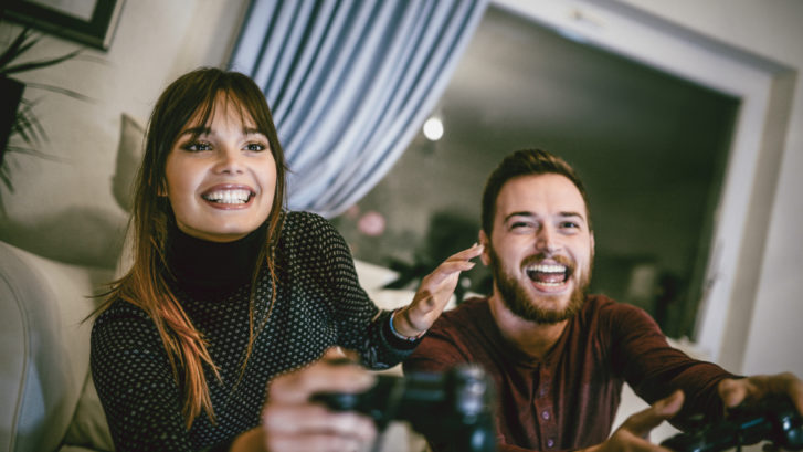 Couple playing video games with intensity